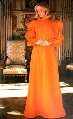 Model wearing an orange evening gown by Courrèges for Jours de France, August 1976