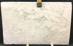 #Mustang #Quartzite has soft gray with accents of black, with beautiful beige veining. Here at Quality Stones we have a large selection of unique and different stones. Come in today and see are selection for yourself. Paul or Samantha will be happy to help you with your project.  #fortmyers #qualitystones #nautralstones Quartzite Countertops, Granite, Fort Myers, Beige, Gray, Natural Stones, Mustang, Hardwood Floors, Texture