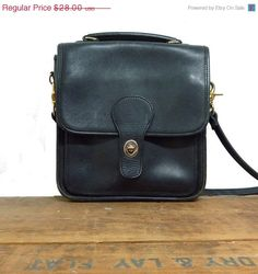 Black over-the-shoulder sachel bag $21