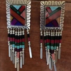 Native American Inspired Sterling Silver Earrings Hello! You are viewing beautiful hand-crafted sterling silver earrings. These Native American inspired earrings have a multicolored stone set in silver and multicolored hanging beads. One earring is missing one hanging bead strand (pictured), but this is not super noticeable. Please feel free to make an offer.  Thanks for checking out my closet! Jewelry Earrings