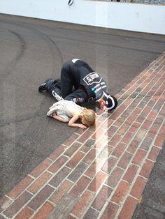 "Jimmie Johnson & His Daughter ""Kiss The Bricks"" after he won the #Brickyard400. #Nascar 7/29/12"
