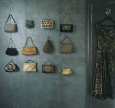 21 More Practical Bag Storage Ideas | Shelterness: purses as wall art