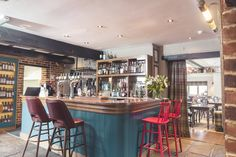 The Queens Head, bar, gastro pub, pub, restaurant, bottles, red stalls, red chairs, dining, casual dining, wooden unit