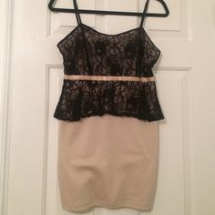 Nude and black lace peplum dress This dress was bought at a local boutique! Only worn once for a family party. Super cute to wear out with heels or flats! Dresses Mini