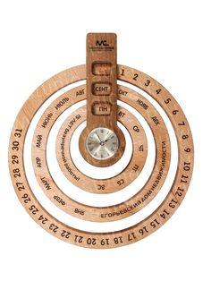 Календари - Очередная идея объединить календарь и часы. Основание - дуб, кольца с датами - бук, лазерная гравировка. Обработка древесины производилась на фрезерном станке с числовым программным управлением. Предусмотрено место для нанесения логотипа или дарственной надписи. Возможно это место для Вас...