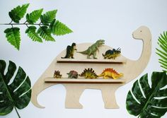 dinosaur nursery For those who are looking for extraordinary shelves to store smaller and bigger toys, we have something special! Shelf in the shape of an dinosaur. Dinosaur Room Decor, Dinosaur Nursery, Dinosaur Kids Room, Baby Room Design, Baby Room Decor, Baby Room Shelves, Ideas Dormitorios, Baby Dinosaurs, Baby Boy Rooms