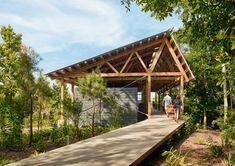 Pine pavilions form Marine Education Center in Mississippi by Lake Flato Architects Lake Flato, Covered Walkway, Ocean Springs, Architect Magazine, Tree Canopy, Pedestrian Bridge, Education Center, Architect Design, Arquitetura
