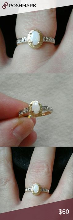 Genuine Opal & Diamond 10K Solid Gold Rg, 7 Elegant, New...Dainty, Solid 10K Yellow Gold, Natural .45ct Oval Opal Center Stone with Genuine .014ct, 1mm, Round Diamonds On Each Side of Band, Size 7, 1.18g...Comes With a Packaged, Polishing Cloth and a Jewelry Pouch or Gift Box. Fine Jewelry Jewelry Rings