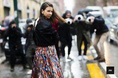 Streetstyle of Natasha Goldenberg wearing a Vêtements bomber jacket and a Marni dress during Milan Fashion Week Fall Winter 2016