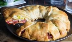Recipe, grocery list, and nutrition info for Spicy Italian Crescent Ring. This crescent ring is loaded with all the delicious flavors of an Italian sub, great for serving at parties or during busy weeknights. Crescent Roll Dough, Crescent Roll Recipes, Crescent Rolls, Quick Recipes, Quick Easy Meals, Easy Dinner Recipes, Cooking Recipes, Easy Cooking, Deli Sandwiches