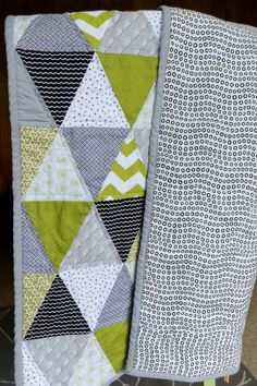 Green, grey, black and white triangle quilt for a baby boy or baby girl.