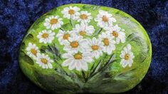 Daisy rock painting. ***Another rock painting that would make a great tiny tattoo! Have a child paint the rock & use that as the design for a great parent/grandparent tattoo.***