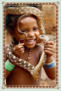 Photo highlights of the day A girl from a snake charmer community plays with snakes on World Snake Day at Raigarh in Chattisgarh, India Beautiful Smile, Beautiful Children, Beautiful People, Kids Around The World, People Around The World, Cute Kids, Cute Babies, World Cultures, Animals For Kids