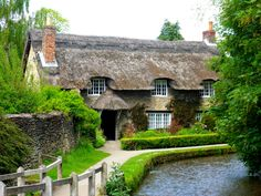 Thornton-le-Dale, Yorkshire. England. Thatched roof cottage.