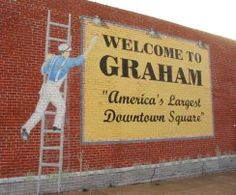 I want to see Texas. There's a horse ranch I'd love to visit in Graham. It also has, as you can see, 'America's Largest Downtown Square'. :)