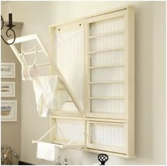I need something like this in my laundry room  DIY: Laundry Room Drying Rack.  @Alana Fowler