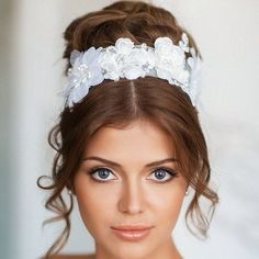 Updo buns with transparent tape with flowers for a wedding