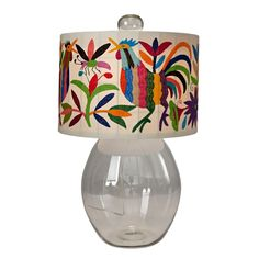 An olive green Otomi fabric shade tops off this handsome lamp. The clear glass base and finial are hand blown in Mexico. We will be offering this lamp with the Olive Green or the Multicolored Otomi fabric shade Kids Decor, Home Decor, Fabric Shades, Lamp Shades, Accent Decor, Clear Glass, Light Up, Embroidery Designs, Stray Dog