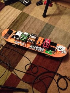 REALLY COOL IDEA & money saver: DIY skate board pedal board for guitar or bass. RESEARCH #DdO:) - https://www.pinterest.com/DianaDeeOsborne/instruments-for-joy/ - INSTRUMENTS FOR JOY. One company offers 1,602 pedals from 158 brand makers. Pedal Board Planner advises: After you plan which to use, plan SIGNAL PATH. Drag pedals up & down to alter path: which order gives best sound? Use a pedal buffer to avoid more bassy or muffled  even with pedal off when you plug in long cord: Screaminfx com