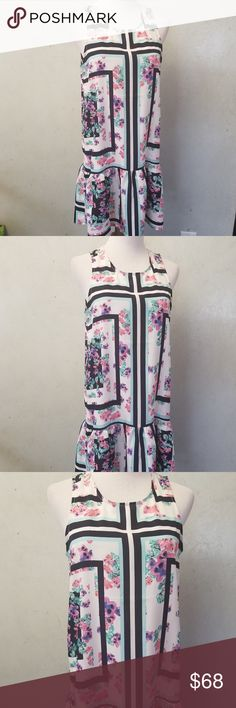 Love + Friends floral dress ( C 89-8) in perfect condition like new, Love + Friends floral block pattern summer dress. 100% polyester. The bust is 19in shoulders are 10in armpit down is 25in Love + Friends Dresses Midi