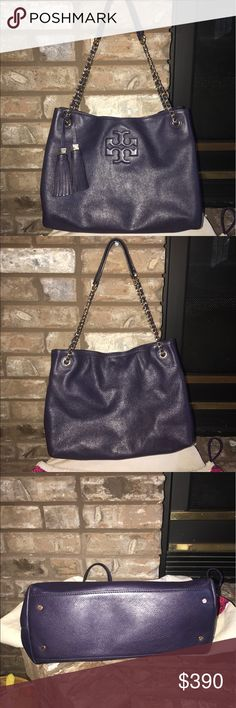 """TORY BURCH THEA SHOULDER BAG-RARE COLOR-EGGPLANT ! This is truly an amazing TORY BURCH THEA SHOULDER BAG IN A AWESOME RARE COLOR .EGGPLANT (kinda deep purple).This Shoulder Bag can actual be worn two two ways- double the straps w/drop of 10"""" as a shoulder bag or one strap w/drop of 18"""" as a cross body!!! The strap is gold metal links braided with eggplant leather🌈🌈 this has a magnetic closure for the whole bag! On the inside there is a FULL SIZED COMPARTMENT IN THE MIDDLE THAT IS ZIPPERED…"""
