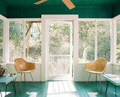 Green sun room. (loving those floors!)