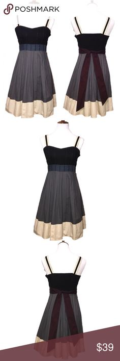 """UO Fit & Flare Apron Sun Dress Urban Outfitters, Silence & Noise midi dress. Contrasting gray, black, cream, moon blue and plum with slight silver stitching at bust. Apron styling, fitted at bust, smocked in back, ties at back waist. Great condition, beautiful dress, shoulder straps have been altered shorter-see size photo and strap measurement photo for details. Appx measurements: bust 15.5"""" (smocked in back expands slightly bigger), empire waist 13.75"""" (measured just below), 33.5"""" length…"""