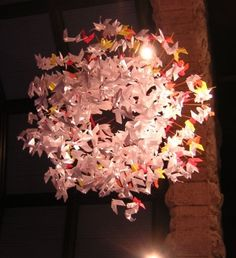 pentecost origami paper doves: Have people write prayers on them the week before & then string up for the next worship.