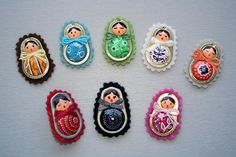 Matryoshkas:  Pop tabs from canned tuna, air dry clay, acrylic paints, permanent markers, felt.