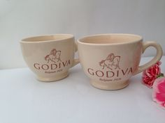 GODIVA MUGS is a Vintage Set of Two Glazed Nude-Colored Porcelain Godiva Chocolate, Coffee or Tea Mugs from Coastal Cocktails, Inc.