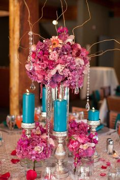 Maybe purple flowers n, teal candles centerpiece