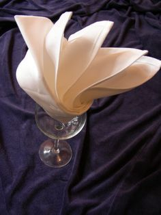 This is a simple but desceptively easy way to fold napkins or serviettes. The result looks dramatic and classy. It works well with both paper and cloth, but care is needed when pulling up the points in the final step if using paper ones so that you dont tear the paper. (after practice on one or two this wont be a problem). I have included step by step photographs  to illustrate and suppliment my written directions. If using paper napkins that come already folded in half and then in half…