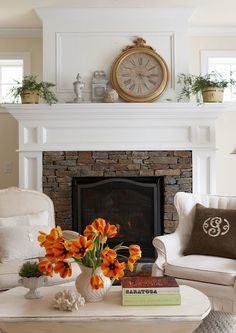 Stacked Stone Fireplace with a white wood mantle. This is how I want my fireplace to look!
