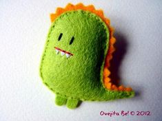 Hey, I found this really awesome Etsy listing at http://www.etsy.com/listing/98399709/little-dragon-felt-brooch