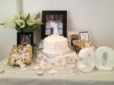 Pearl Wedding Anniversary-- like the table decor!! can get cheap pearl necklaces!!