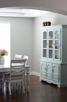 I like the painted hutch...overall I like the color scheme in this house.  I don't think grey walls will work in our house though...not with the oak wood everywhere...    dining room by croskelley, via Flickr
