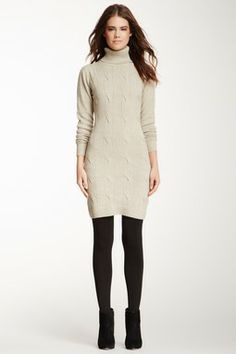Ivory sweater dress, black opaque tights, black booties