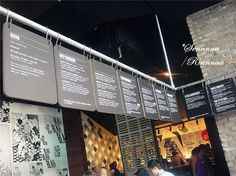 Simple menu displays- Flat aluminum displays with vinyl graphics like these would make changing the menu relatively simple; The use of meat hooks as well bring another atheistic from the restaurant to it.