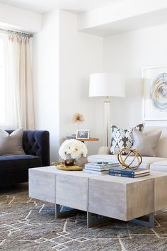 Amazing living room features side by side agate art placed over a light grey linen roll arm sofa ...