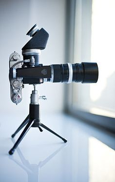 interesting contraption.   is that a leica with a viewfinder and what else?... i can't tell them apart
