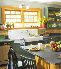 Vintage Farmhouse Sink- (WOW) An oversize vintage farmhouse sink sets the casual tone of this kitchen. Shop for old sinks at salvage yards and plumbing suppliers. Or buy a new sink that just looks old. Reproduction cast-iron farmhouse sinks feature foot-high backsplashes and ridged drainboards -- just like their older cousins.
