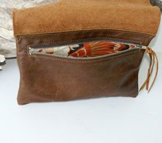 Raw Edge Leather Bag - Leather Clutch - Brown Leather - Burnt Caramel Leather - Womens Handmade Handbags - One of a Kind by Marge and Rudy    From my Raw Collection. Each bag from my Raw Collection is ONE OF A KIND! No two are exactly alike, as unique as the women who carry them.    Simple. Raw. Beautiful.    Brown Leather with Burnt Caramel Leather. Natural beauty. Notice the shading and pull marks on the front flap. Simply Stunning!    Lined in a gorgeous coordinating upholstery fabric…