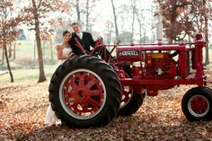 Bride and groom on red tractor - do you think this was the get away car?