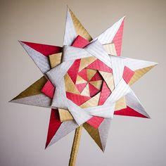 Find out how to fold a fantastic origami star for Christmas - Braided Corona Star designed by Maria Sinayskaya. Video tutorial by Sara Adams. Diy Origami, Origami And Kirigami, Origami Paper Art, Origami Folding, Origami Stars, Origami Tutorial, Paper Folding, Diy Paper, Paper Crafts
