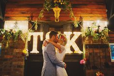 #initials, #marquee-lights  Photography: Jonathan Ong - www.jonathanong.com  Read More: http://www.stylemepretty.com/2014/08/20/whimsical-country-wedding-in-australia/