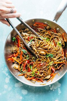 15 Minute Lo Mein! made with just soy sauce, sesame oil, a pinch of sugar, ramen noodles or spaghetti noodles, and any veggies or protein you like. SO YUMMY! vegan, vegetarian.| http://pinchofyum.com