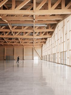 An undulating, multi-pitched roof covers the timber-framed Congress and Exhibition Centre, designed by architects Emanuele Bressan and Andrea Botter. Zhengzhou, Glass Curtain Wall, Glass Building, Timber Structure, Roof Plan, Ground Floor Plan, Contemporary Architecture, Wood Architecture, Pavilion