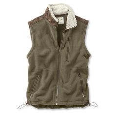Sherpa Lined Fleece Vest. Warm 10-oz. fleece with a Sherpa-pile interior and a handsome heathered look makes our lined vest a perfect way to beat winter's chill. Faux-leather trim and Swiss-made zippers ensure durability in even the harshest conditions. Three fleece-lined exterior pockets. Drawcord-adjustable hem. Polyester/rayon. Washable. Imported.