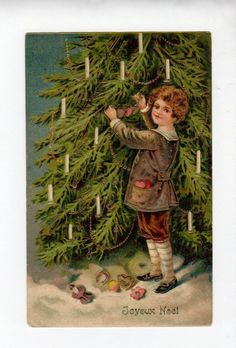 French Christmas card featuring a little boy decorating his Christmas tree with lighted candles.