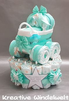 Windeltorte + Windelkinderwagen + Schnuller Mint You are looking for a nice gift for: - birth - christening - baby shower or just as a small gift? Diy Diapers, Baby Shower Diapers, Baby Boy Shower, Baby Shower Gifts, Baby Gifts, Diaper Shower, Shower Cake, Girl Baby Shower Decorations, Baby Shower Centerpieces